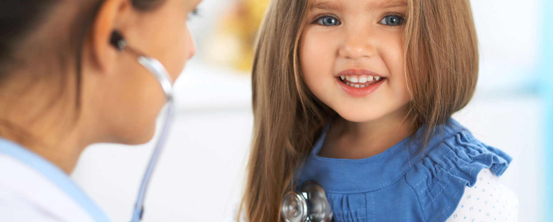 Young girl with medical professional